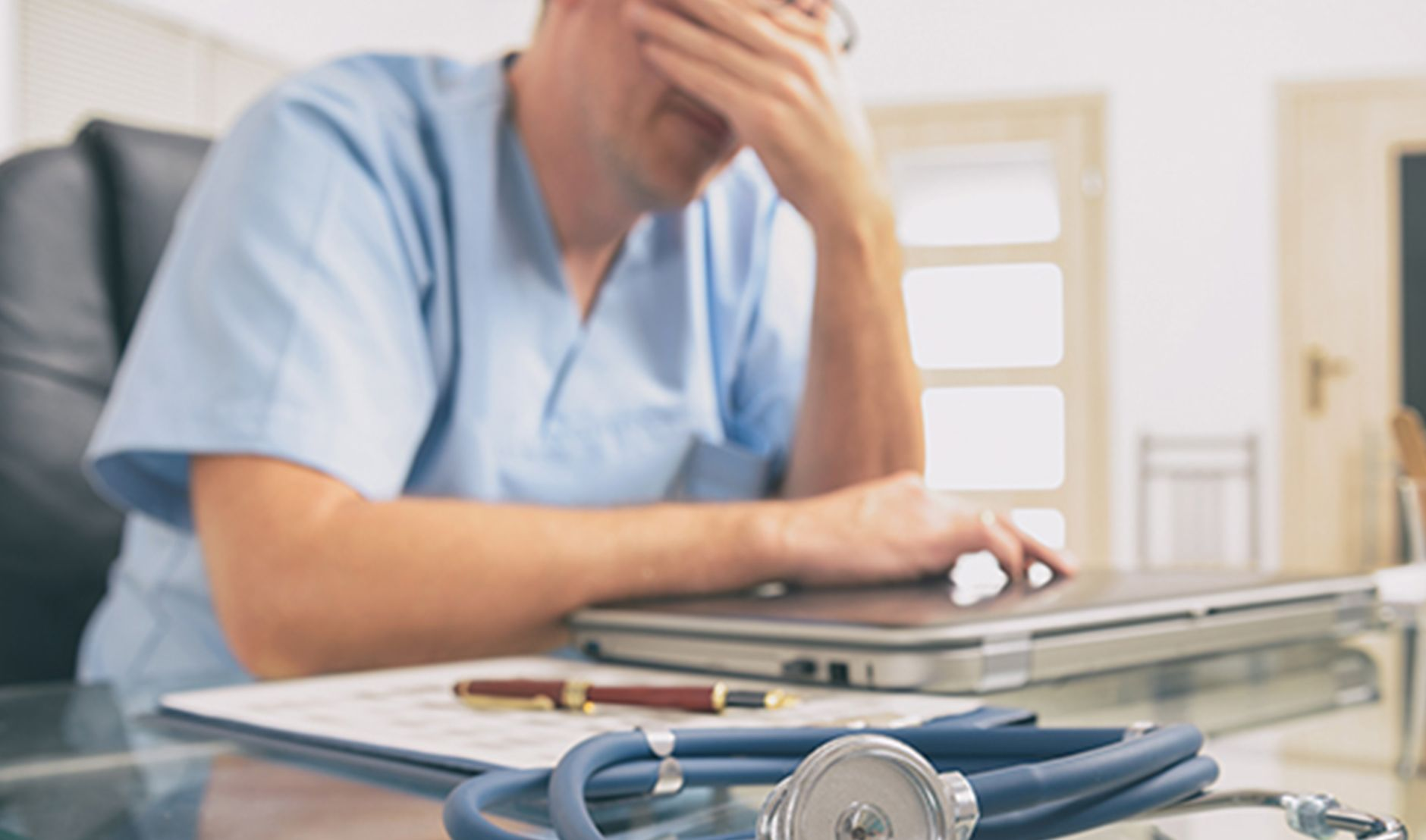 male doctor stressed job