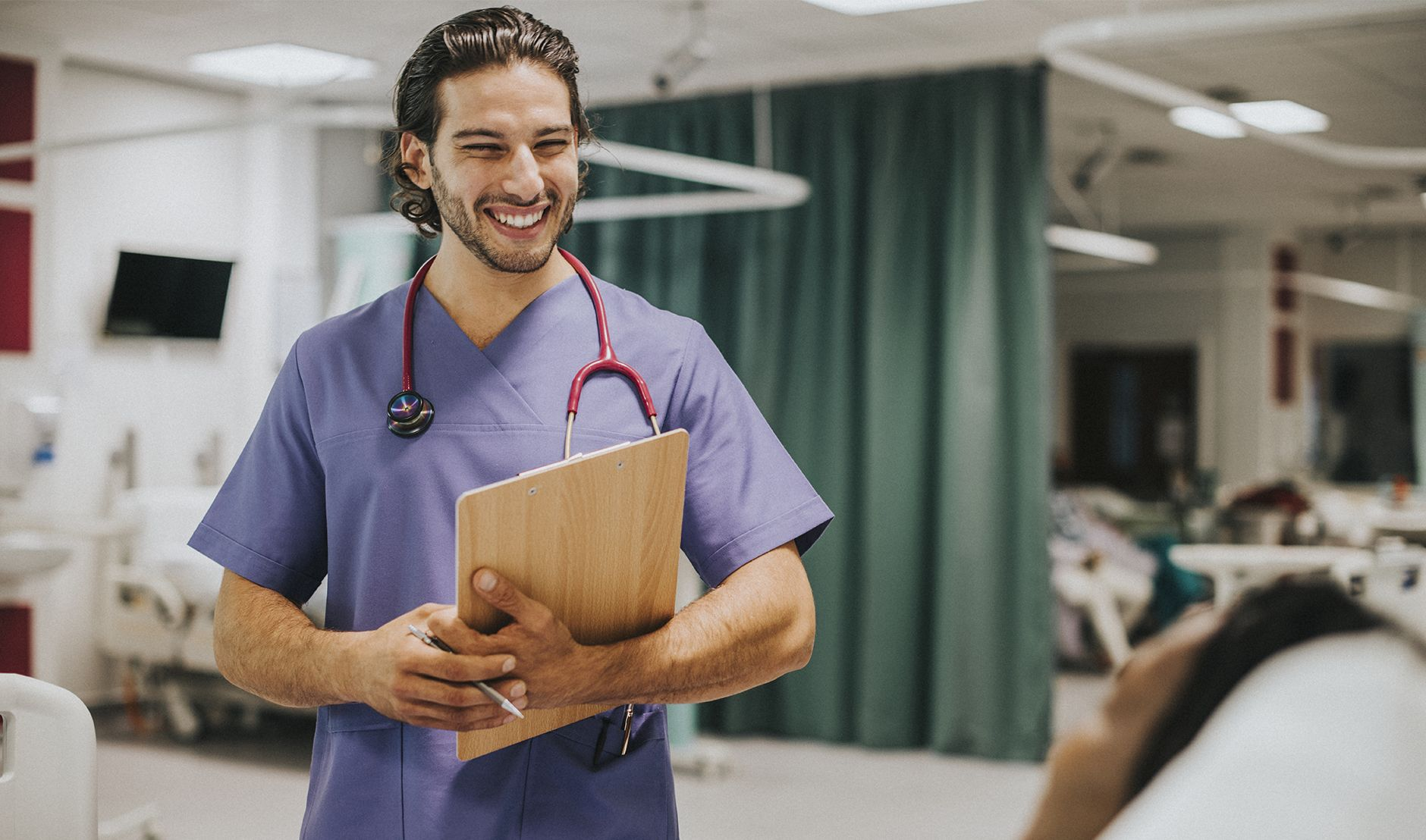 male doctor laughing - working in aunz